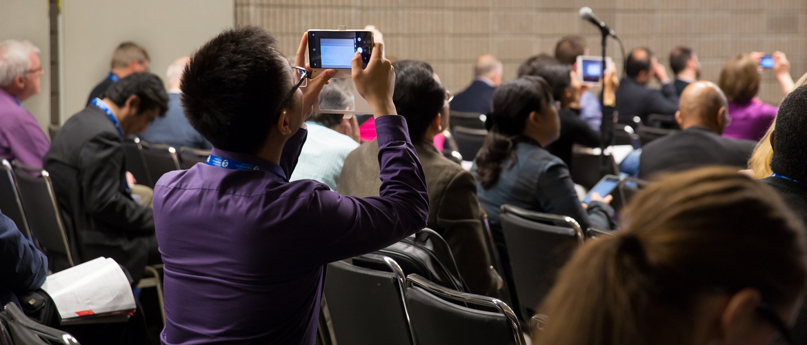 Man taking a picture during conference of dementia.