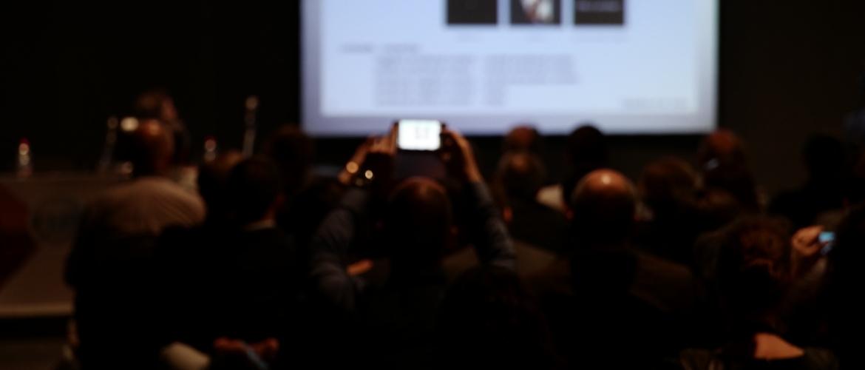 Spectators viewieng the presentation